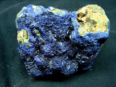 Azurite: NM; 2.5-4.5 Hardness; no cleavage; blue-brown (light); blue streak; non magnetic