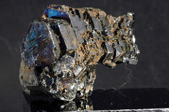 Hematite: Metallic; 5.5-6.5 hardness; no cleavage; dark metallic gray; light brown streak; slightly magnetic