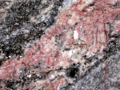 potassium feldspar: NM (glossy); 6.5 Hardness; Cubic Cleavage; light pink; no streak; light pink with lighter white part; Chemical Formula: KAlSi3O8
