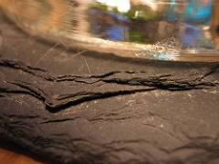 Slate: Foliated; no visible grains; shingle-like; flat, slatey, breaks into sheets, cleavage; Parent Rock: Mudstone or Shale